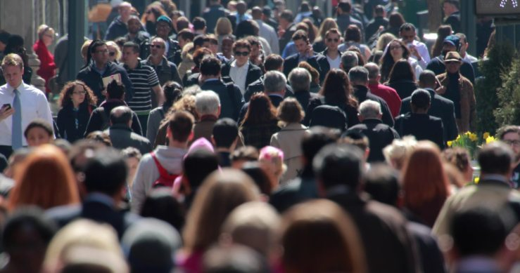 stock-footage-new-york-city-april-crowd-of-people-walking-on-street-sidewalk-k-e1418682210242.jpg